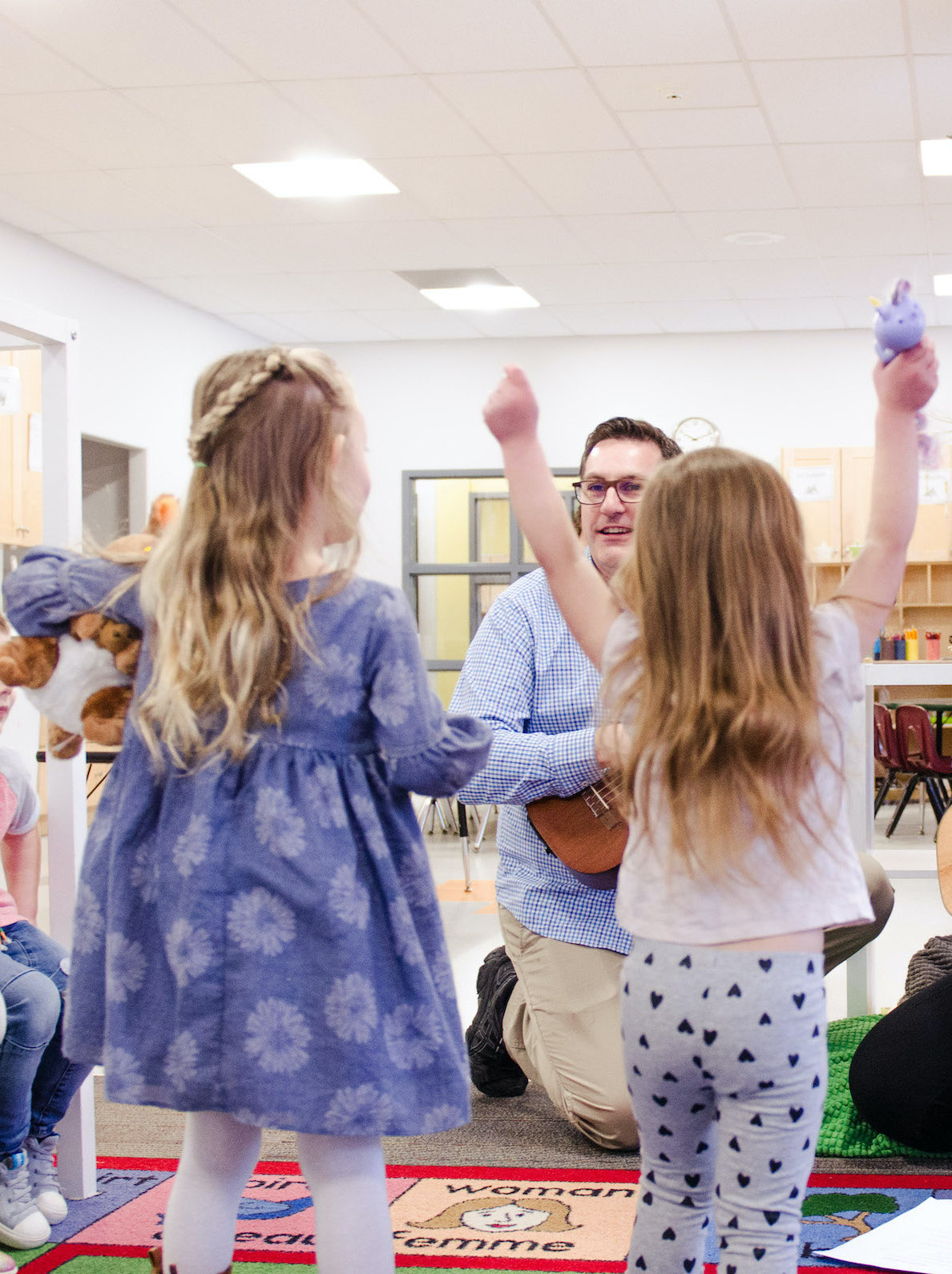 Brightling children sing and dance with caregivers