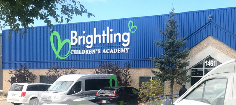 Brightling Childcare Academy building and transport vans.