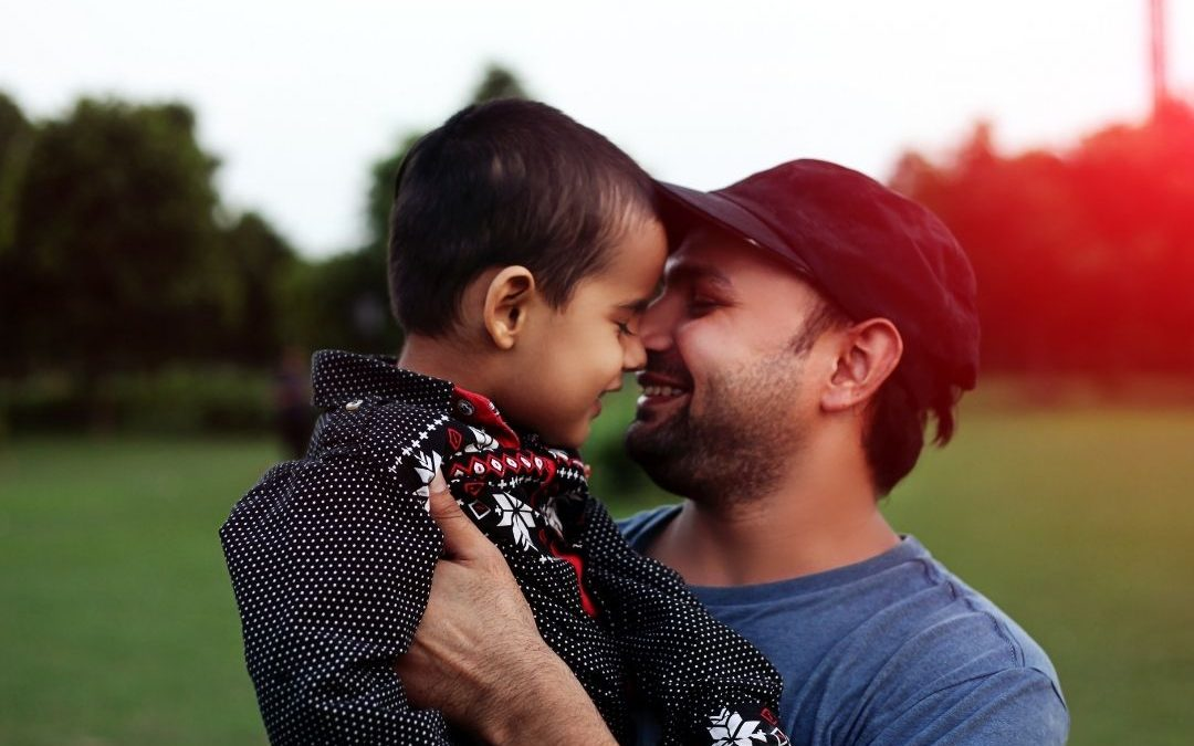 Dad and son smiling
